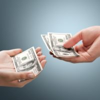 couples hands holding money