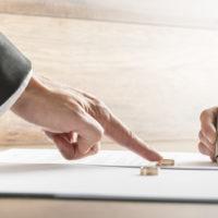 woman-signing-a-divorce-form-jpg-crdownload