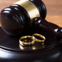 wedding-bands-on-a-gavel-platform