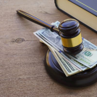 stack-of-cash-under-gavel-jpg-crdownload