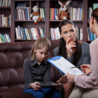 Mother and daugther in therapy session.jpg.crdownload