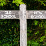 Wooden sign that reads old:new school