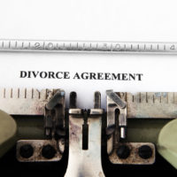 paper that reads divorce settlement
