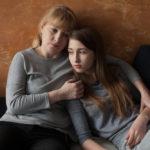 Mother talks to grown child about her divorce.jpg.crdownload