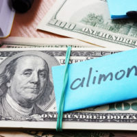 money with allimony sign.jpg.crdownload