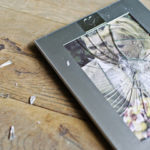 Marriage photo cracked on the floor to indicate how common divorces are in America