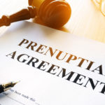 prenup agreement with pen and gavel on table