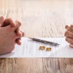 Couple's Hand On Divorce Agreement