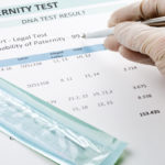 Doctor points at result on paternity test result form