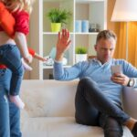 Young couple having difficulties at parenting together
