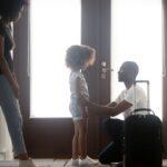 African dad talking to upset mixed-race kid daughter saying goodbye