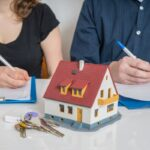 Divorce and dividing a property concept. Man and woman are signi